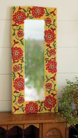 "Very unique mirror from Acacia - frame is hand-hooked wool in a suzani-inspired floral pattern (12"" x 28"")"
