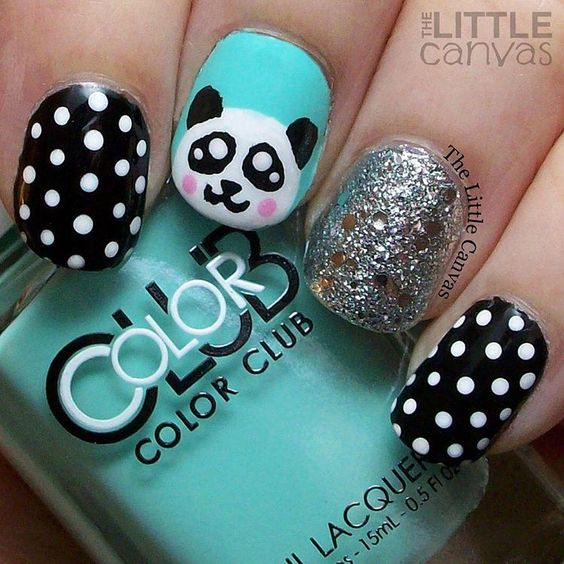 Panda nail art!!! Love this little guy. The mint polish is @colorclubnaillacquer Blue-Ming!  Such a fabulous color.