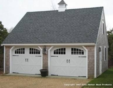 Estimating the cost of building a two car garage cars for Build carriage garage doors