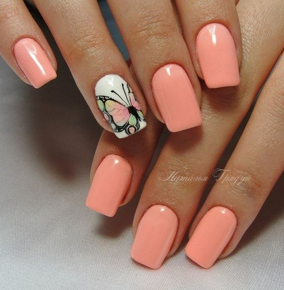 In this manicure is used the main neon peach gel nail I'm Brighter Than You by brand Gelish. A butterfly on a white background draw by a hand by gel colors – this, of course, an aerobatics of nail wizard. To Simplify the task at home will help the popular slider design nowadays.
