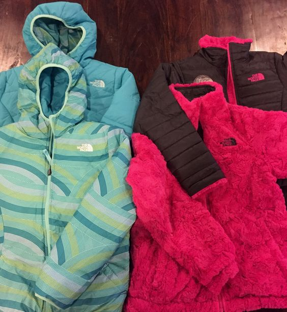 Don't let your kids freeze in this cold weather! Come in and get them a reversible The North Face Jacket. 2 cute jackets in 1!