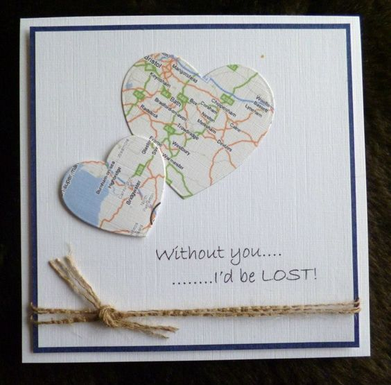 handmade Valentine card ... clean and simple ... two hearts die cut from a map ... great sentiment ...