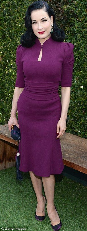 Perfect in plum: Dita Von Teese struck a vintage style note with her demure dress teamed with coordinating heels