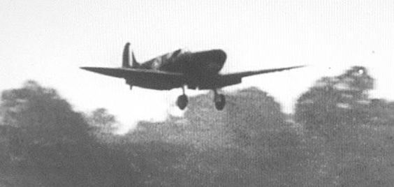 A Spitfire of 64 Squadron, flaps down, lands at Kenley during the Battle of Britain.