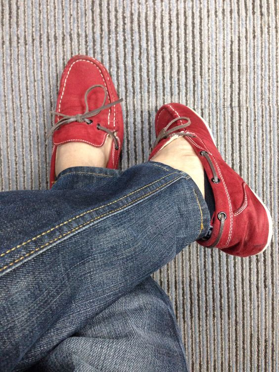 JayQ on crimson red Sperry top sider.