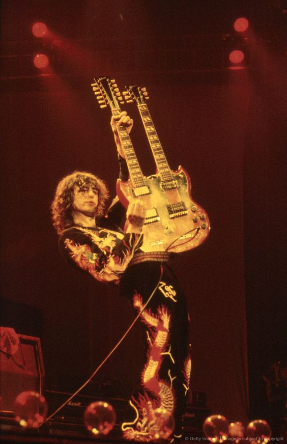 "Led Zeppelin Live               ""Page In His Pomp""       Legendary guitarist, Jimmy Page performs his heavy classic ""acoustic crescendo passage moments before his electrifying solo on Stairway to Heaven!"" Earl's Court  London - 18th May 1975  Getty Images: Graham Wiltshire 