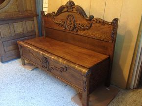 Repurposed antique oak 3/4 size bed frame into a functional bench seat. Used the original railings for the side and made a storage bin under the bench seat. Would look great inside a home or on enclosed porch.