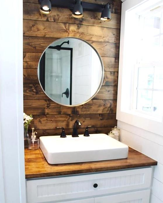 Stained Wood Walls Behind The Bathroom Sink And Bedroom Loft Add Warm Touches Of Color In 2020 Tiny House Bathroom House Bathroom Designs Bathroom Tub Shower