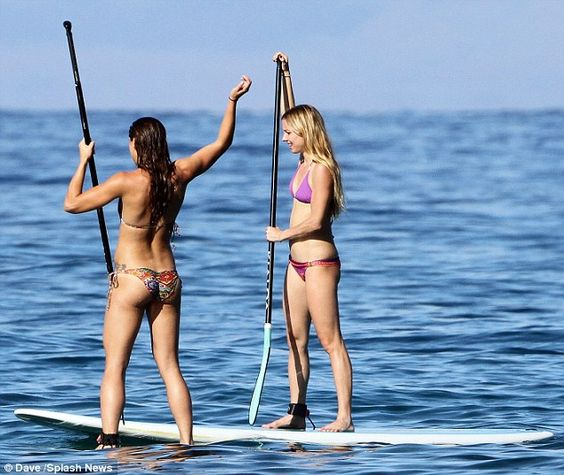 Alex Morgan and a friend paddle-boarding in Maui, Dec. 20, 2012. (Dave/Splash News/Daily Mail)