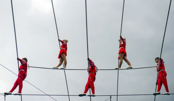High-wire dancers of the acrobat group Geschwister Weisheit (wisdom siblings) perform on the tightrope on May 25, 2013 during the German Gymnastics Festival in Frankfurt am Main, western Germany. The gymnastics competition and sports-for-all event is running until May 25, 2013 in several venues of the Rhine-Neckar region. Organisers expect more than 80,000 participants. AFP PHOTO / Nicolas Armer / GERMANY OUTNicolas Armer/AFP/Getty Images