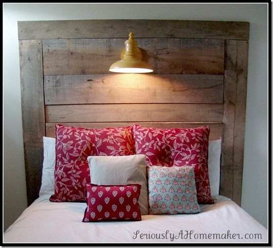 Barn wood headboard wih a built in lamp. Love it!