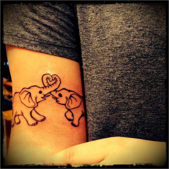 Tattoo: Two Elephants with trunks in heart shape