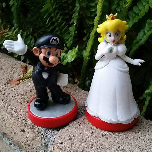 pair of super mario bros video game wedding cake toppers