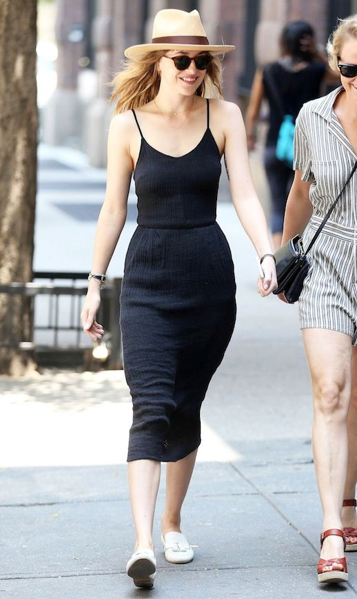 Actress Dakota Johnson sure knows how to rock a little black dress for summer! Here she is in a straw hat, a fitted black strappy dress and cool white loafers. This is the perfect look for any hot summer day out and about in the city.