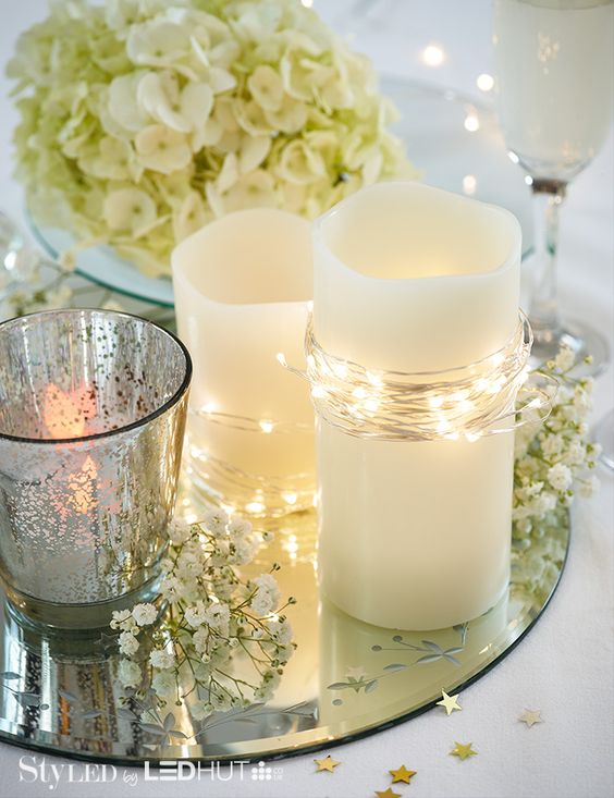Get creative: LED candles & fairy lights + flowers + mirrors = this stunning centrepiece… Perfect for a wedding or party! #StyLEDlighting