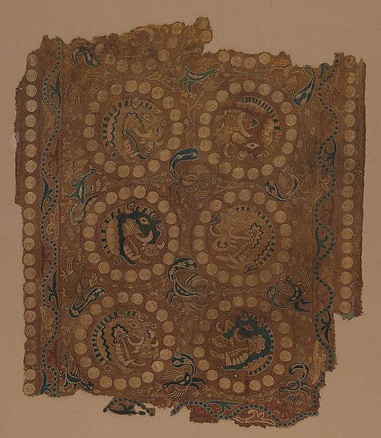 Textile with Boar's Head Roundels -  Date:     7th century Culture:     Iran, Afghanistan or China (Xinjiang Autonomous Region) Medium:     Silk split-stitch embroidery on plain-weave silk