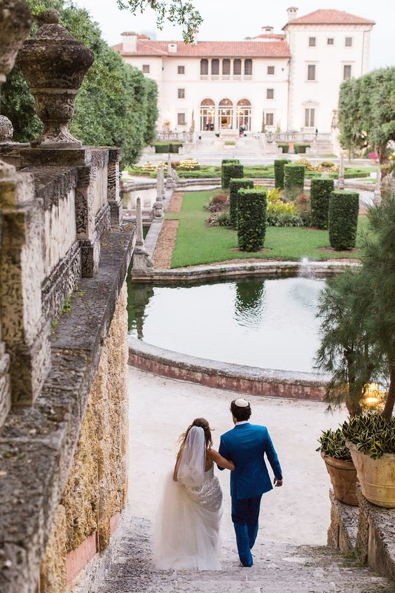 hola - Vue Photography To the reception they go!  Vizcaya Museum and Gardens dress by: Mira Zwillinger Grooms suit: Michael Andrews Bespoke