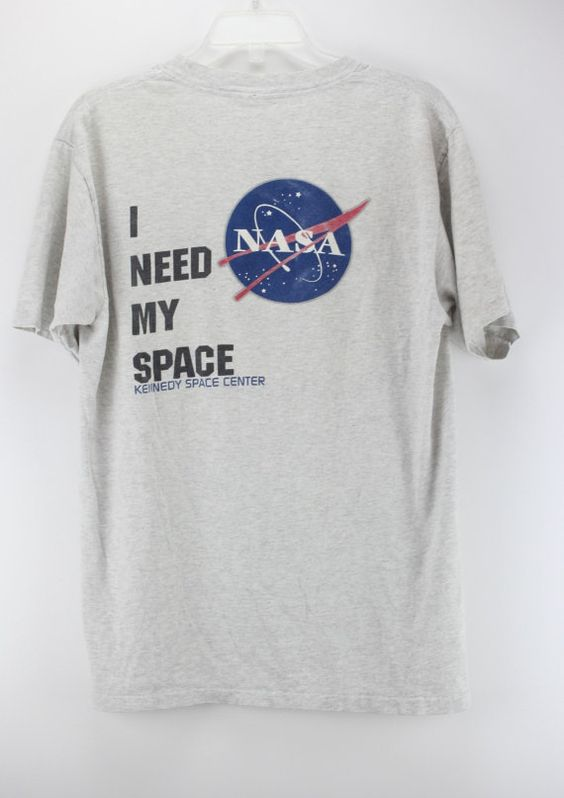 Heres a nice old t shirt featuring Nasa and the Kennedy Space Center. Good vintage condition. I NEED MY SPACE LOGO is on the back of the t shirt.