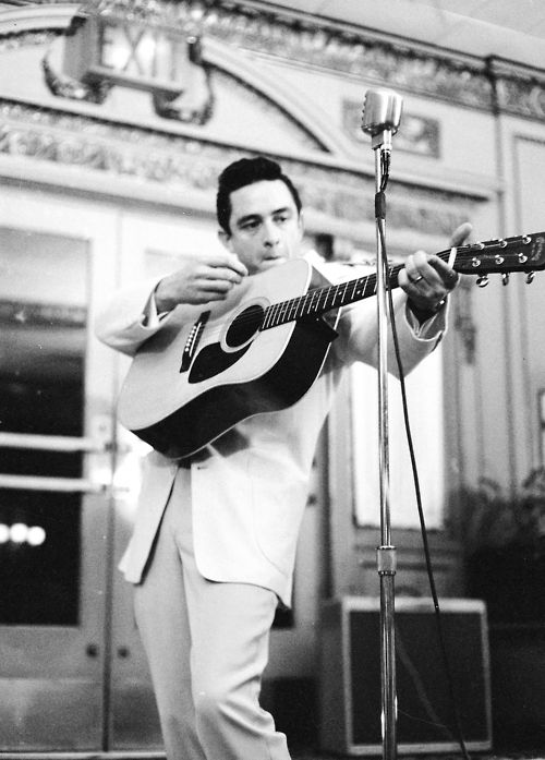 Johnny Cash on his Martin guitar, circa 1959.