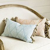 We took our popular Belize fabric by the yard and turned it into a decorative pillow, so you can add fresh tropical color to your seating or bed top. Made of 100% cotton and hand finished with natural jute tassels and triangular fringe. Belize Fringe Pillow features: Luxurious feather-down insertHidden zipperSwatches availableMade in the USA