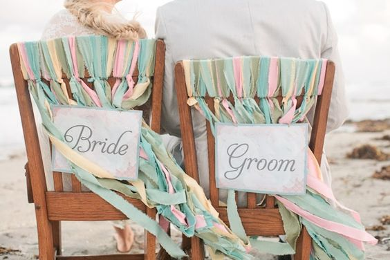bride + groom chairs with ribbons // photo by Chelsey Boatwright furniture from UnearthedVintage.com