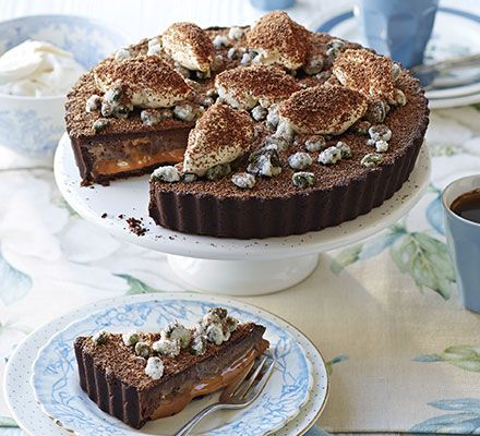 Double chocolate & caramel tart, frosted pistachios & rum cream: A stunning layered dessert to impress dinner party guests - assemble everything ahead of time for stress-free entertaining
