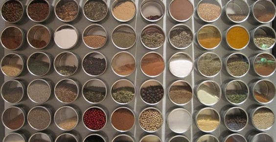 Magnetize Your Spice Jars. You really don't need all those souvenir magnets your parents sent you from their travels. Buy some magnetic spice jars from World Market or similar places and use your refrigerator as a makeshift spice rack.