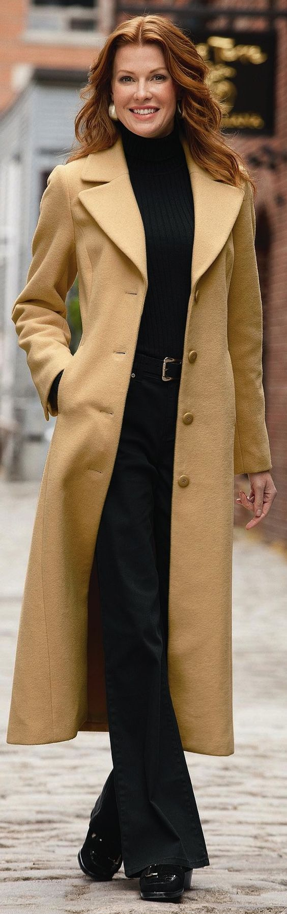 Truly a modern duster coat given modern lapels, length, buttons, and fit.