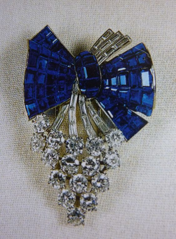 The Queen Mother`s Diamond & Sapphire, Bunch of Grapes brooch, now worn by the Queen.:
