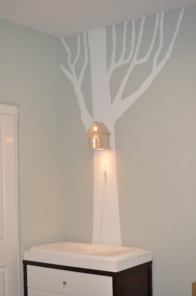 perhaps not the bird house lamp but i like the idea of a tree silhouette painted onto the wall and accented with something 3d