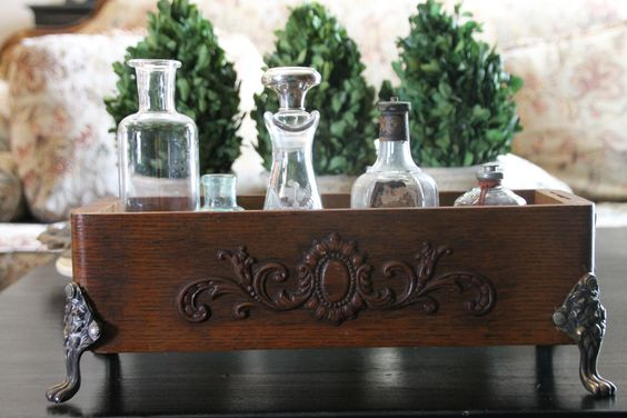 Laura Beining-Tollander-Antique sewing drawer...I went to Goodwill and found an old silver trivet, I had my husband remove the feet and simply glued them on the drawer! I love it!: