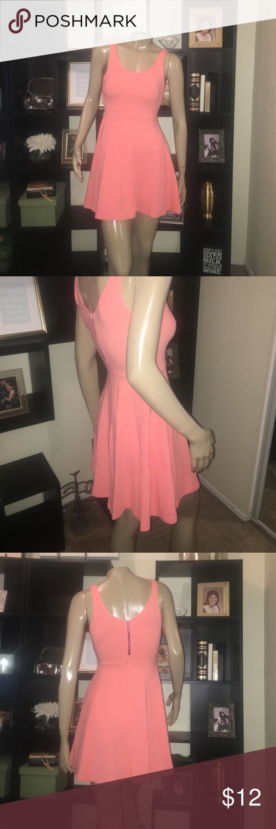 Peach  Express Skater Dress Size small. Worn once. Perfect condition. Peach color and pink zipper. Express Dresses Mini