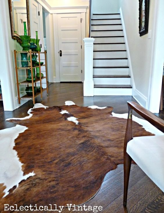 Eclectically Vintage Foyer - hide rug
