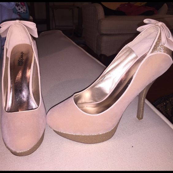 Champagne & pink heels Size 10 never worn have literally sat in my closet and moved around w me for 2 hours years. There's a stain on the inside on the heel (I uploaded a picture of it). It's negotiable Charlotte Russe Shoes Heels