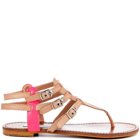 Stay cute in the Saahti!  Steve Madden brings you this spunky sandal featuring a natural leather upper with a pop of pink at the sides.  You'll love the adjustable trio of buckles for a perfect fit.
