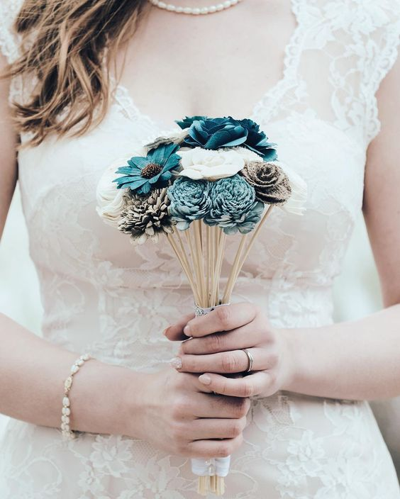 Bouquet made from recycled paper products. by blackandgoldphoto