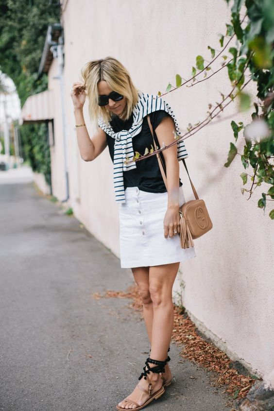 White denim skirt + black t-shirt + striped sweater