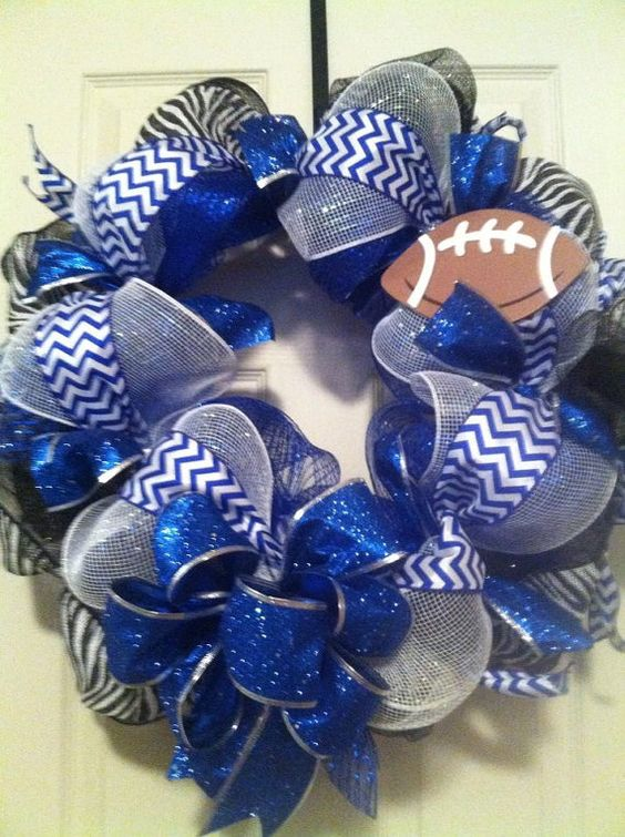 Dallas Cowboy/ Indianapolis Colts/ Deco Mesh Wreath. This could be for your high school or for your main squeeze of a team such as one of my faves. The Colts!!! Awesome blue and white chevron with Burlap zebra ribbon. What sets this above everything else is the amazing glitter two inch ribbon that just sparkles. I can add a team sign to this, or an iniital for your last name. Whatever you choose. Let's create something awesome for your front door!