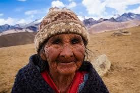 Typical Bolivian Woman, with not such high incomes, or assets. But still a big smile on her face.