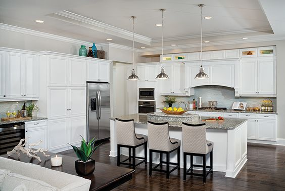 This white kitchen shows the latest in functionality and kitchen style ideas!  Notice the stylish pendant lights. Bluffton Luxury Designer Home Photos at http://www.arthurrutenberghomes.com/find-a-home/community-specific-page/image-gallery/?state_id=SC&community_id=4233&area_no=11&plan_id=79645