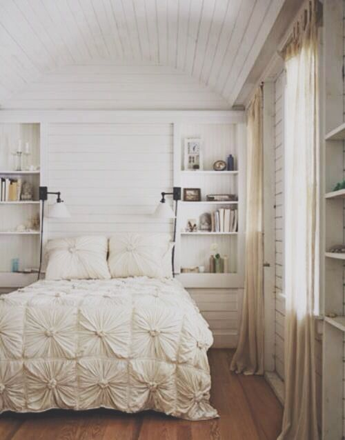 wood walls. white. cool lights for small space. I like the bookshelves on the side with the mounted lights.