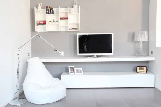 Sala minimalista - home office e sala.