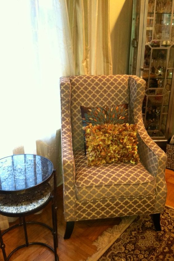 Pier 1 Alec Wing Chair, Sparkle Gold Nesting Tables and pillows. A quiet corner for Uncle Bob