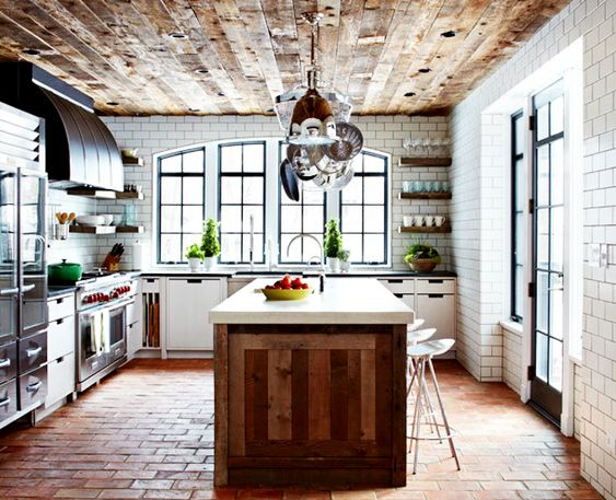 reclaimed wood ceiling, ceramic floor tiles, subway tiles with black grout and industrial appliances