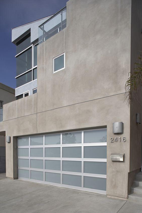 Overhead Door Modern Aluminum garage doors' light-filtering glass delivers a striking complement to your contemporary home.