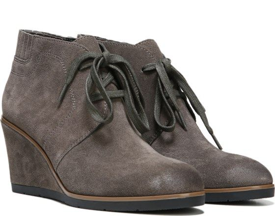 Capture a high-fashion, utilitarian look in this chic lace-up wedge bootie. Suede upper. Lace-up front. Subtle stitching and seaming detail. 3 inch covered wedge heel.