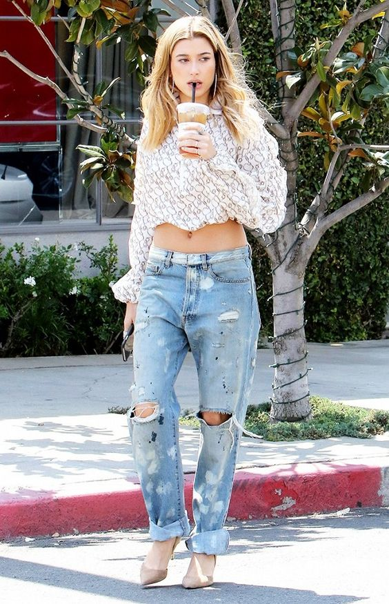 Hailey Baldwin adds a bit of polish to her torn boyfriend jeans and cropped top with a pair of mid-heel pumps