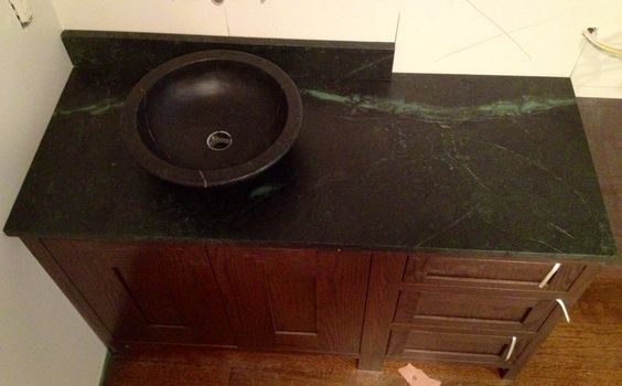 Soapstone Vessel Sink : Soapstone counter and backsplash with soapstone vessel sink.