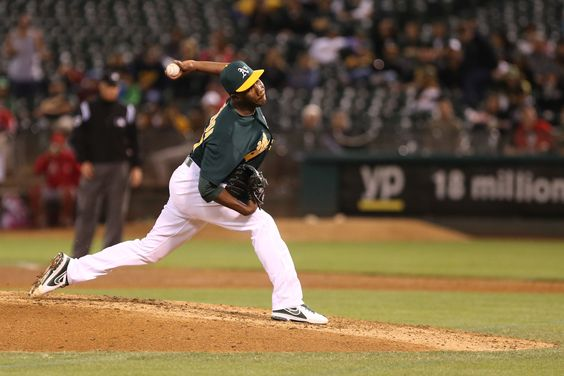 CrowdCam Hot Shot: Oakland Athletics relief pitcher Pedro Figueroa pitches the ball against the Los Angeles Angels during the eighth inning at O.co Coliseum. Photo by Kelley L Cox