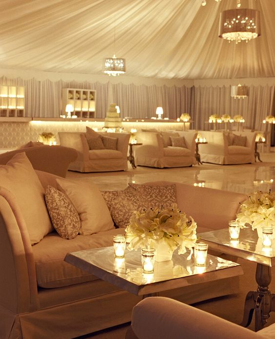 An All White Lounge: The key to pulling off the effect was tons of candlelight, which warmed up the space instead of feeling cold or uninviting. The lounge tent held the cocktail bar, dance floor and plenty of cushy seating to create a laid-back vibe where guests could really start to party after dinner.
